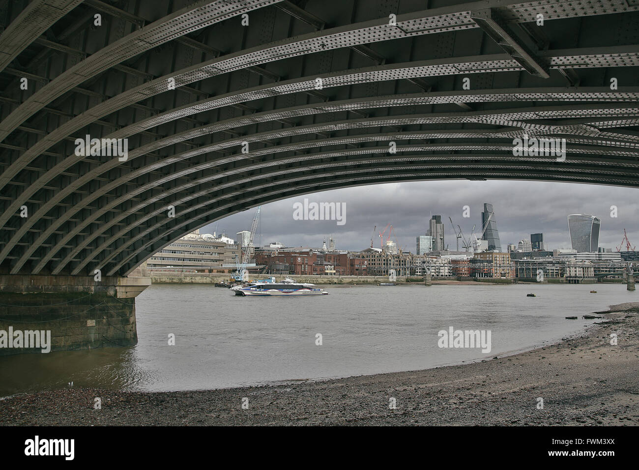 City Buildings Seen From Below Blackfriars Bridge Over Thames River - Stock Image