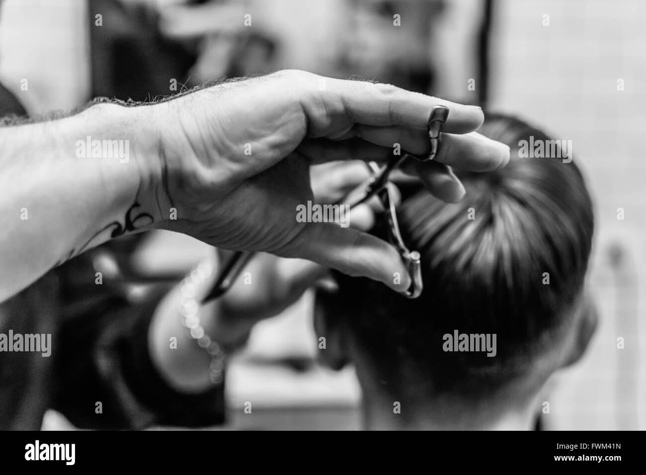Hairdresser Cutting Boy Hair At Salon - Stock Image
