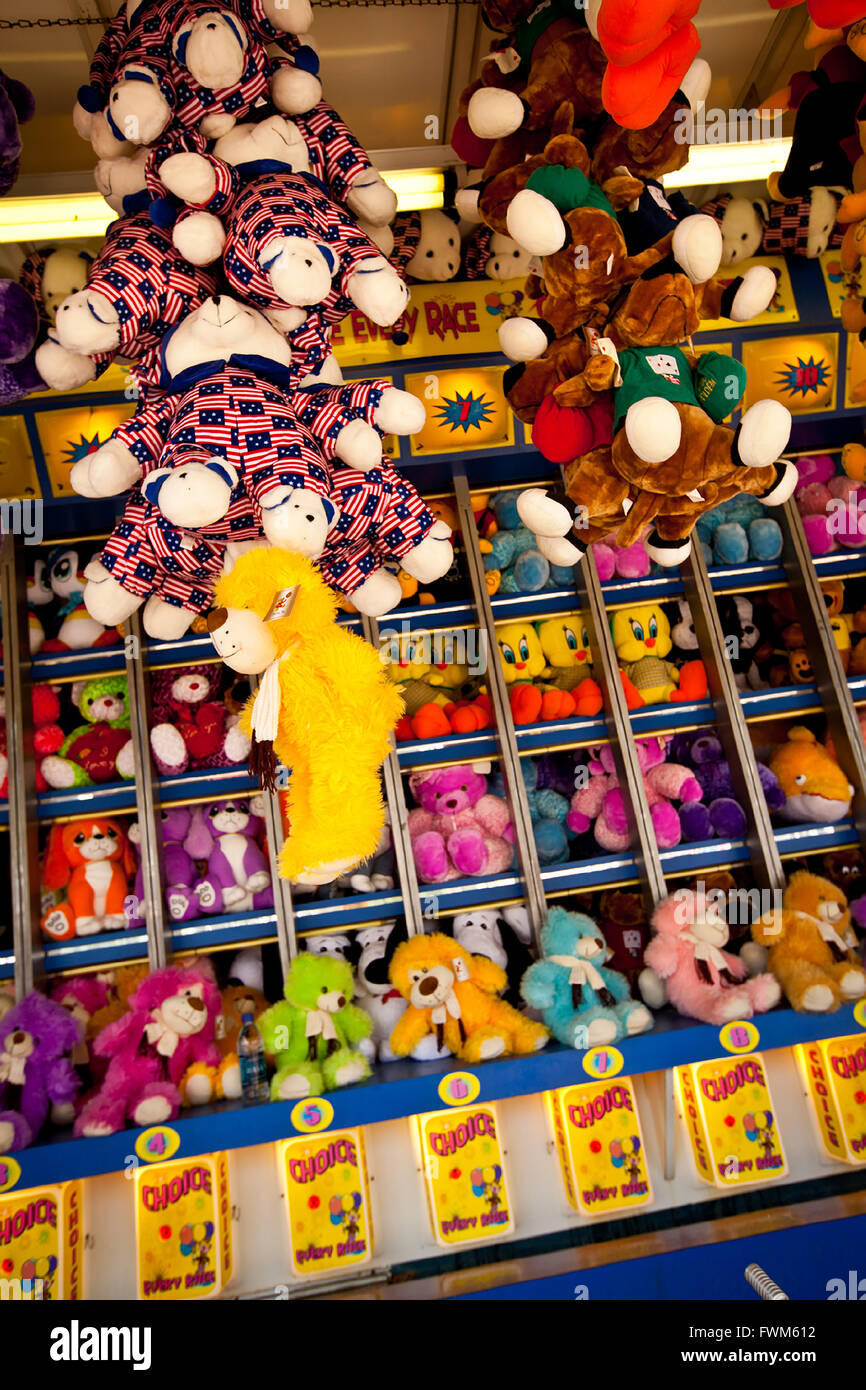 Carnival game to win stuffed animals during a country fair in St. George, SC - Stock Image
