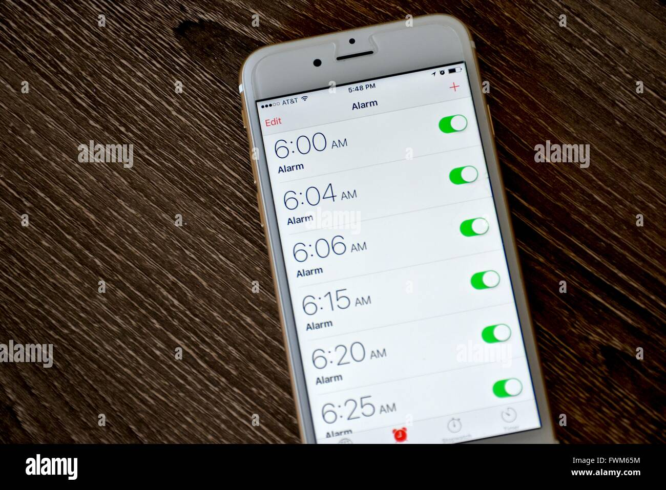 how to set alarm on iphone 6 an apple iphone 6s displaying the alarm clock application 20307