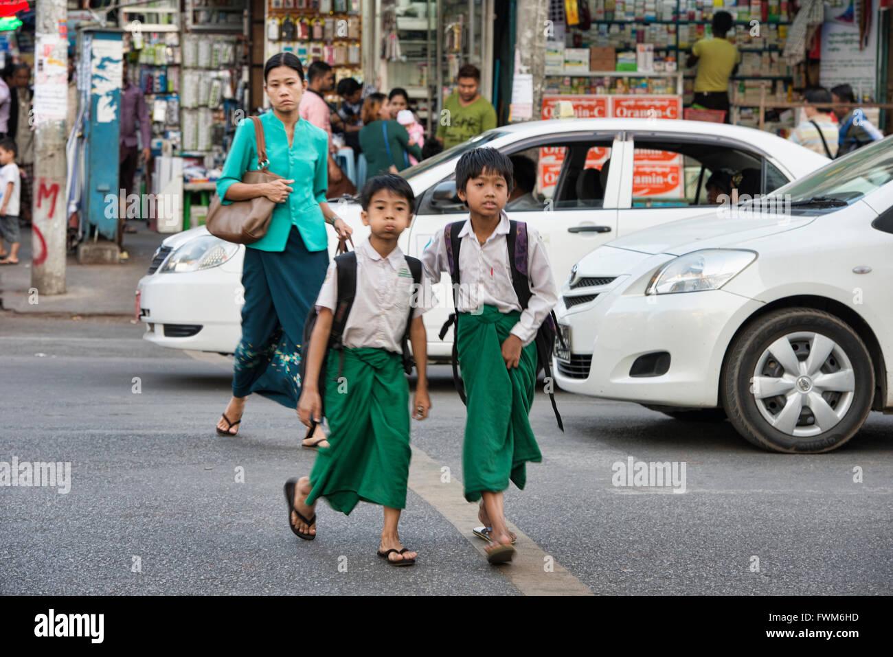 Schoolboys walking, Yangon, Myanmar - Stock Image
