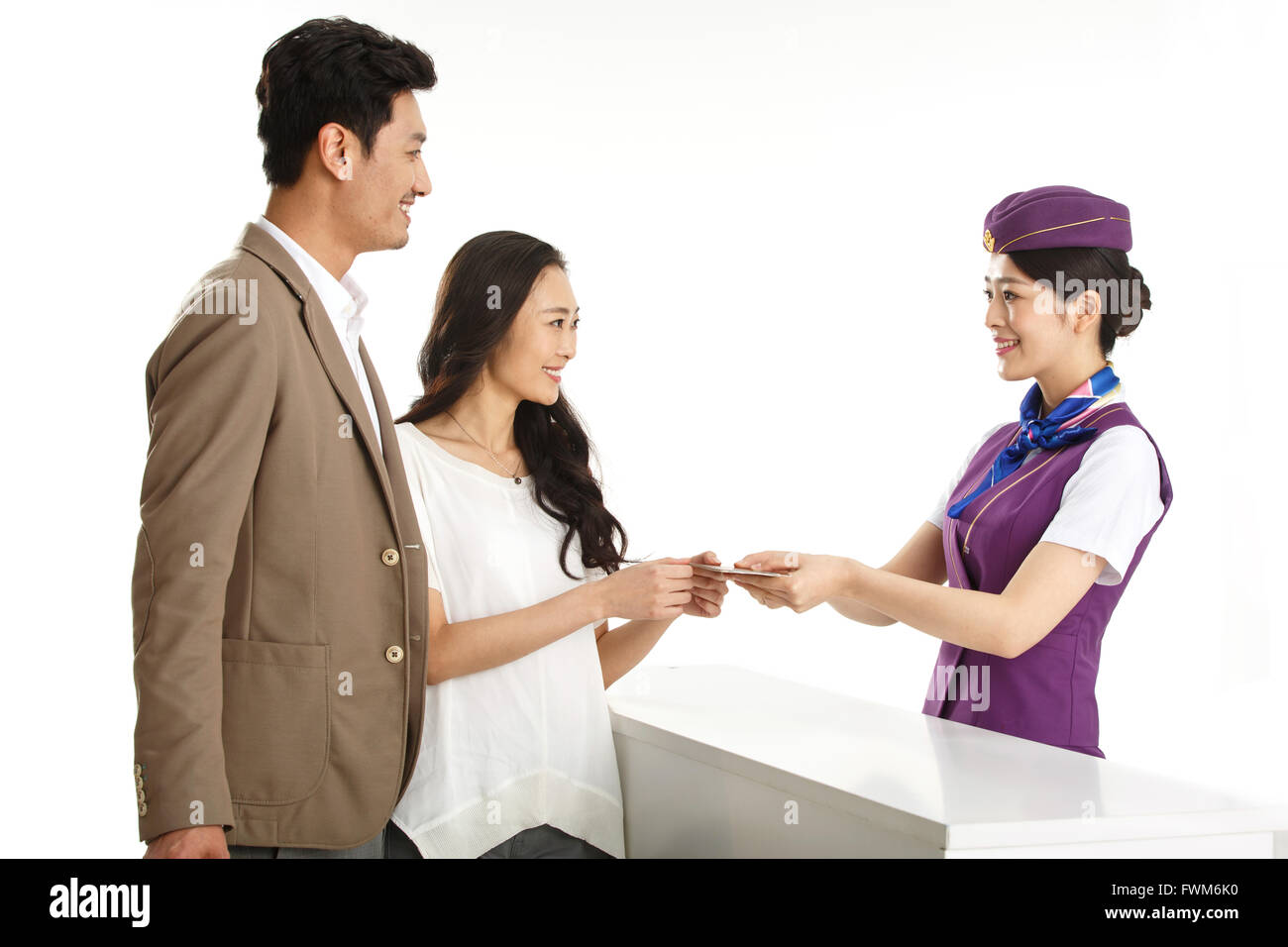Young female flight attendants for customers to pass a passport - Stock Image