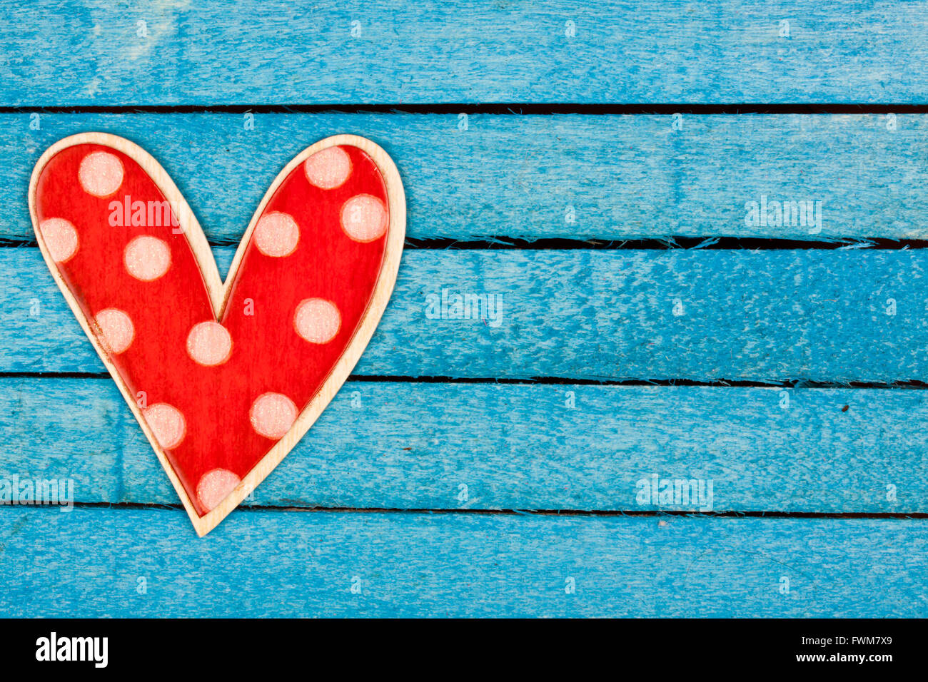 red polka dot heart - Stock Image