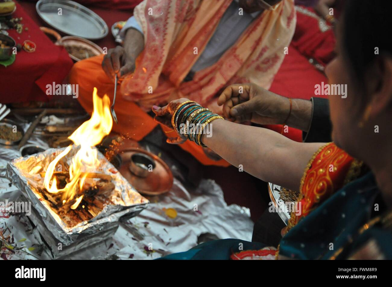 Bride And Groom Performing Rituals At Wedding - Stock Image
