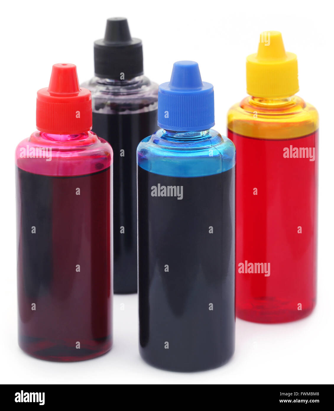 Printer ink bottles over white background - Stock Image