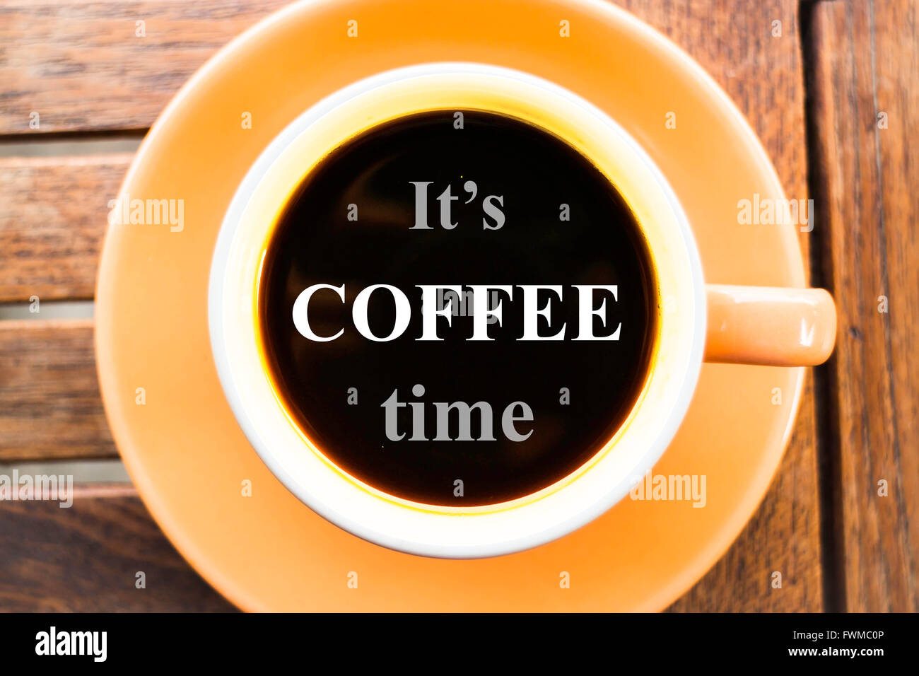 it is coffee time inspirational quote on coffee cup stock photo
