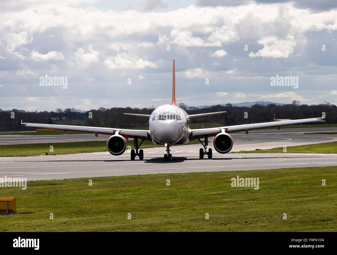 easyJet Airbus A320-214 Airliner G-EZUF Taxiing on Arrival at Manchester International Airport England United Kingdom - Stock Image