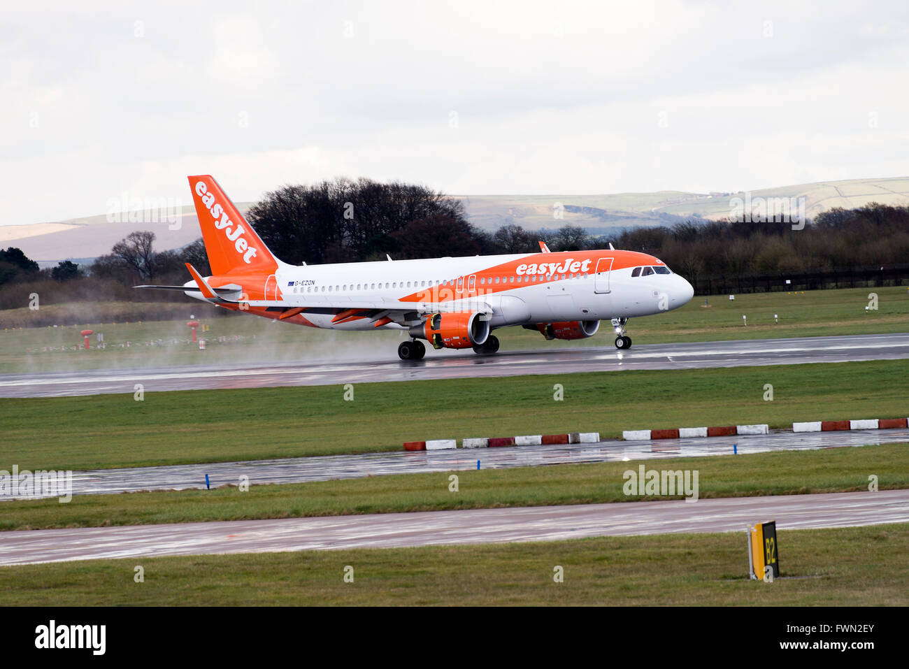 easyJet Airbus A320-214 Airliner G-EZON Landing on Arrival at Manchester International Airport England United KingdomStock Photo