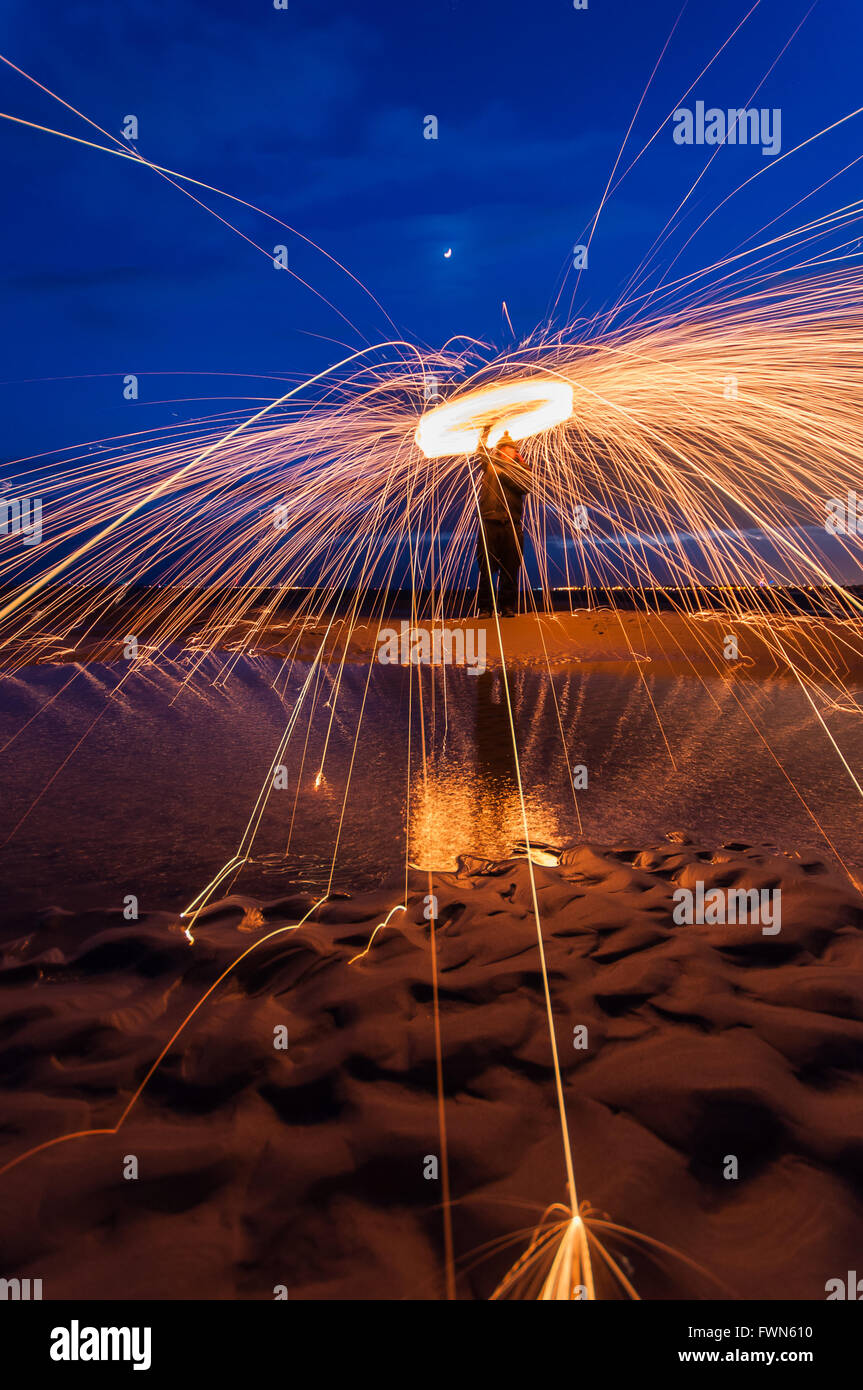 Wire wool spinning on Hayling Island beach - Stock Image