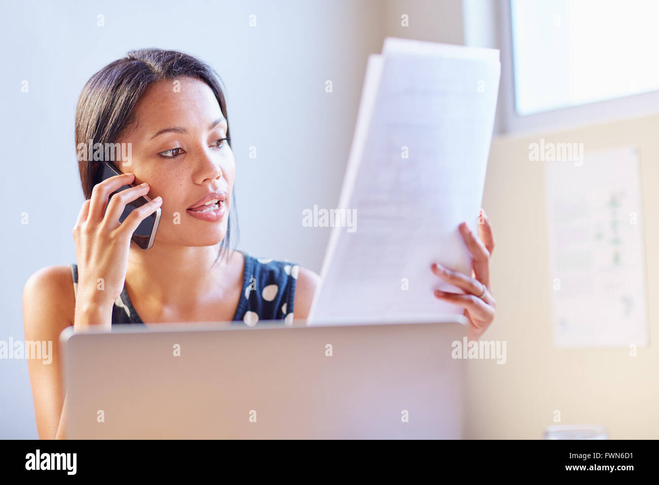 Ensuring her documents are in order - Stock Image