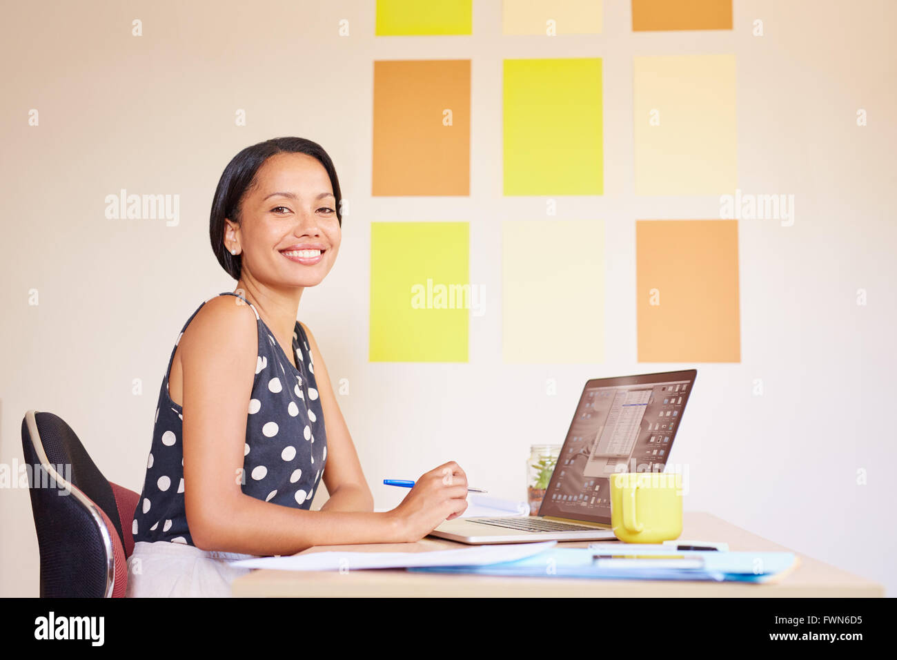 Enjoying every second at her dream job - Stock Image