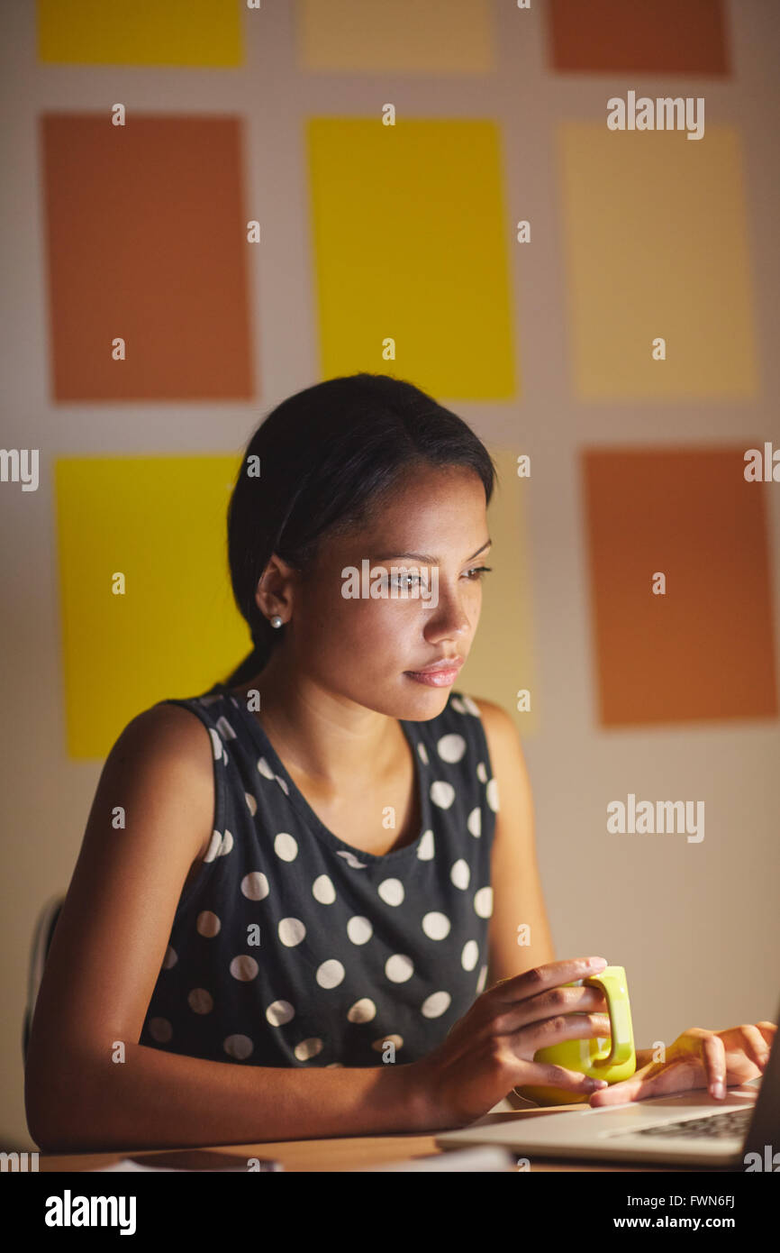 Late night browsing from the office - Stock Image