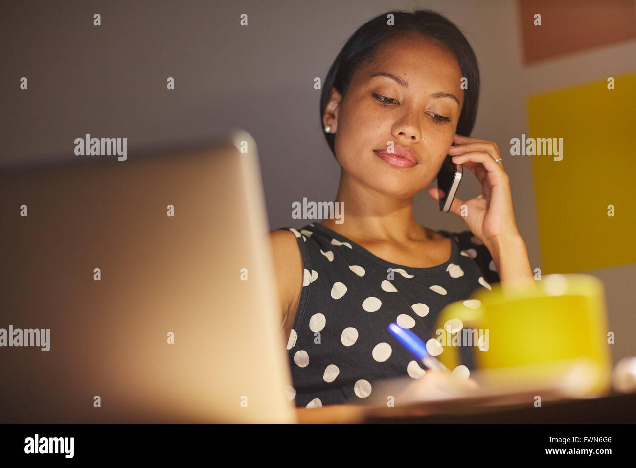Late nights at work get the job done - Stock Image