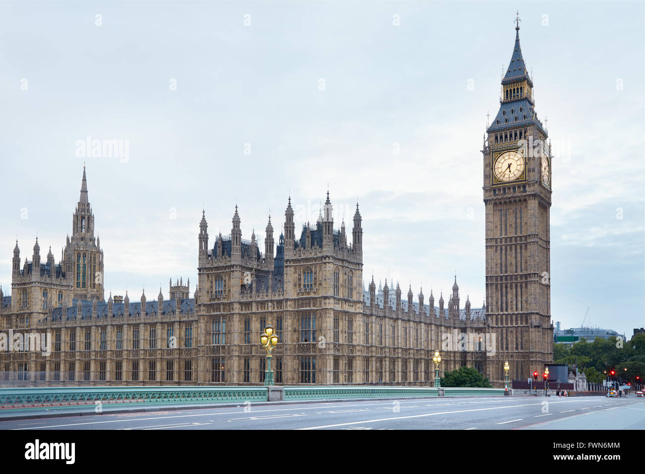 Big Ben and Palace of Westminster in the early morning, empty street in London - Stock Image