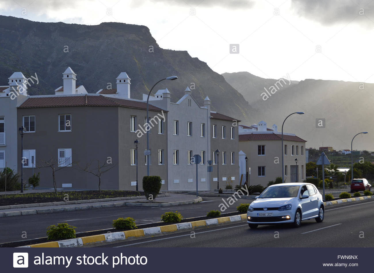 Town of Buenavista Del Norte modern houses with Teno mountains in background, Tenerife Canary Islands Spain - Stock Image