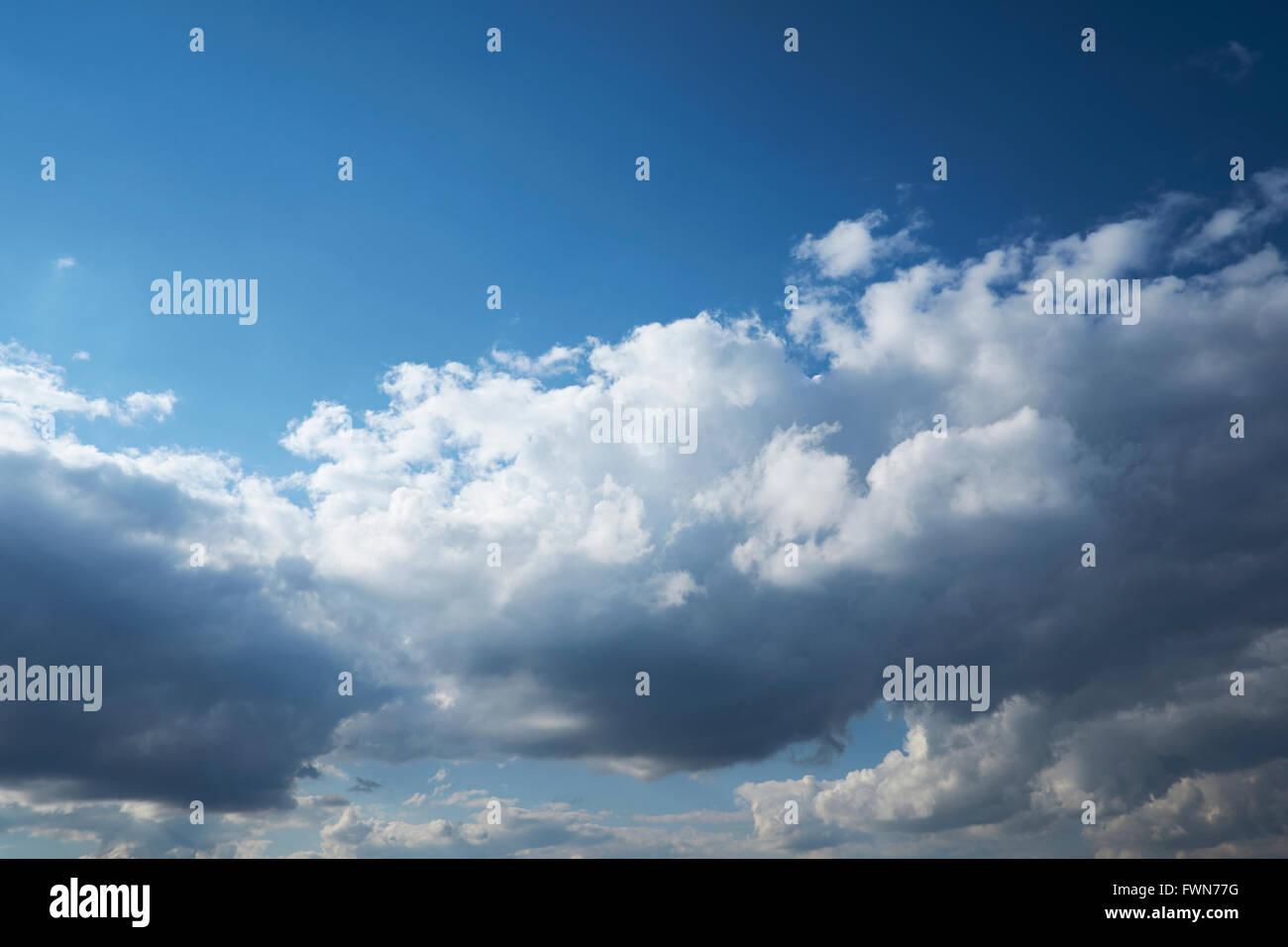 Cumulonimbus cloud formations against a bright blue sky. UK. - Stock Image