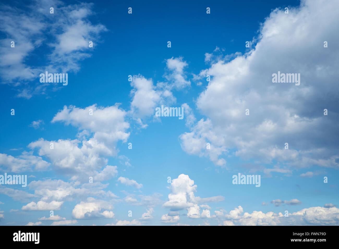 Cumulonimbus cloud formations against a bright blue sky. UK. Stock Photo