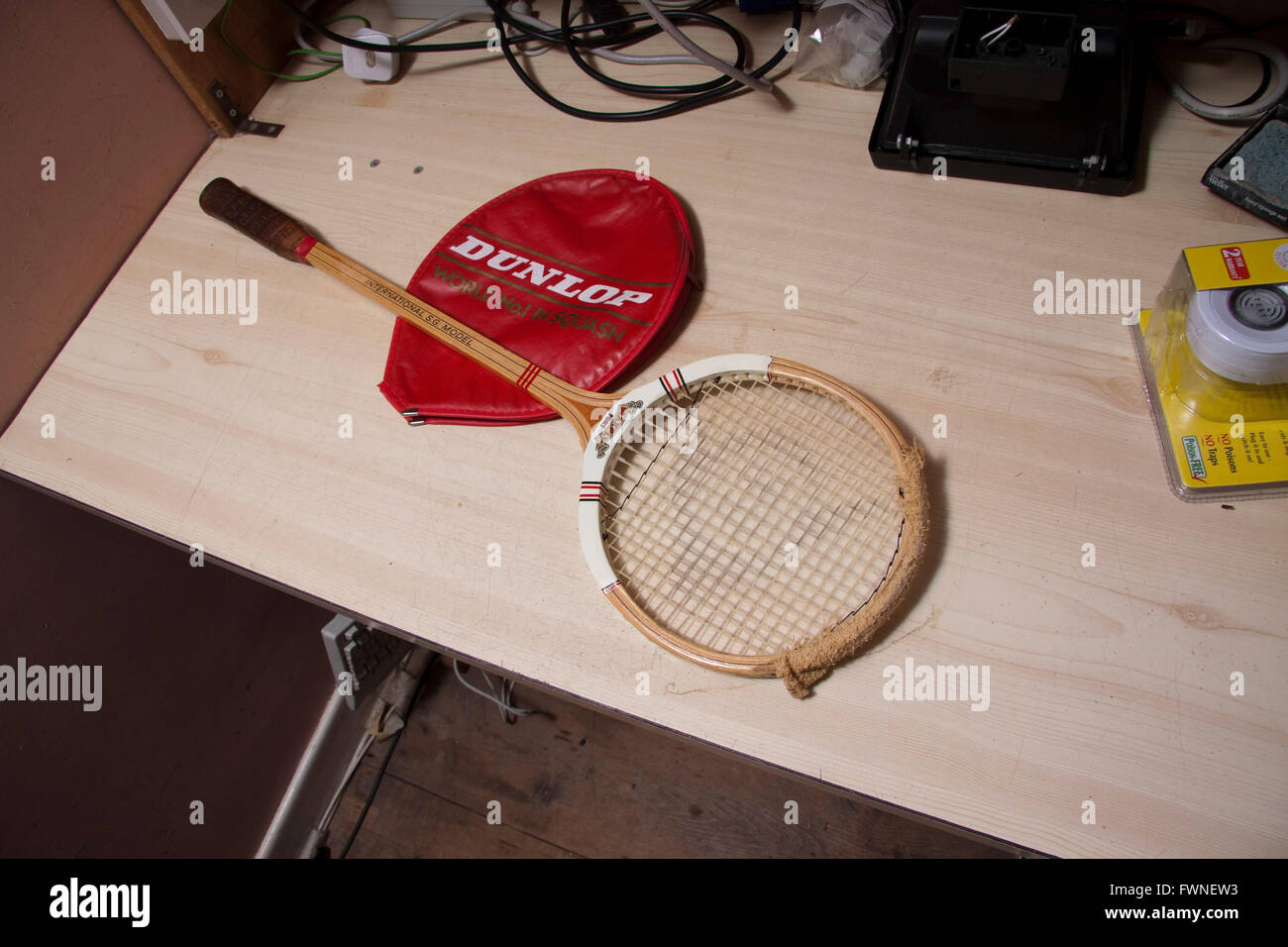 A Dunlop Maxply Squash Racquet/racket With Cover On A Work Bench