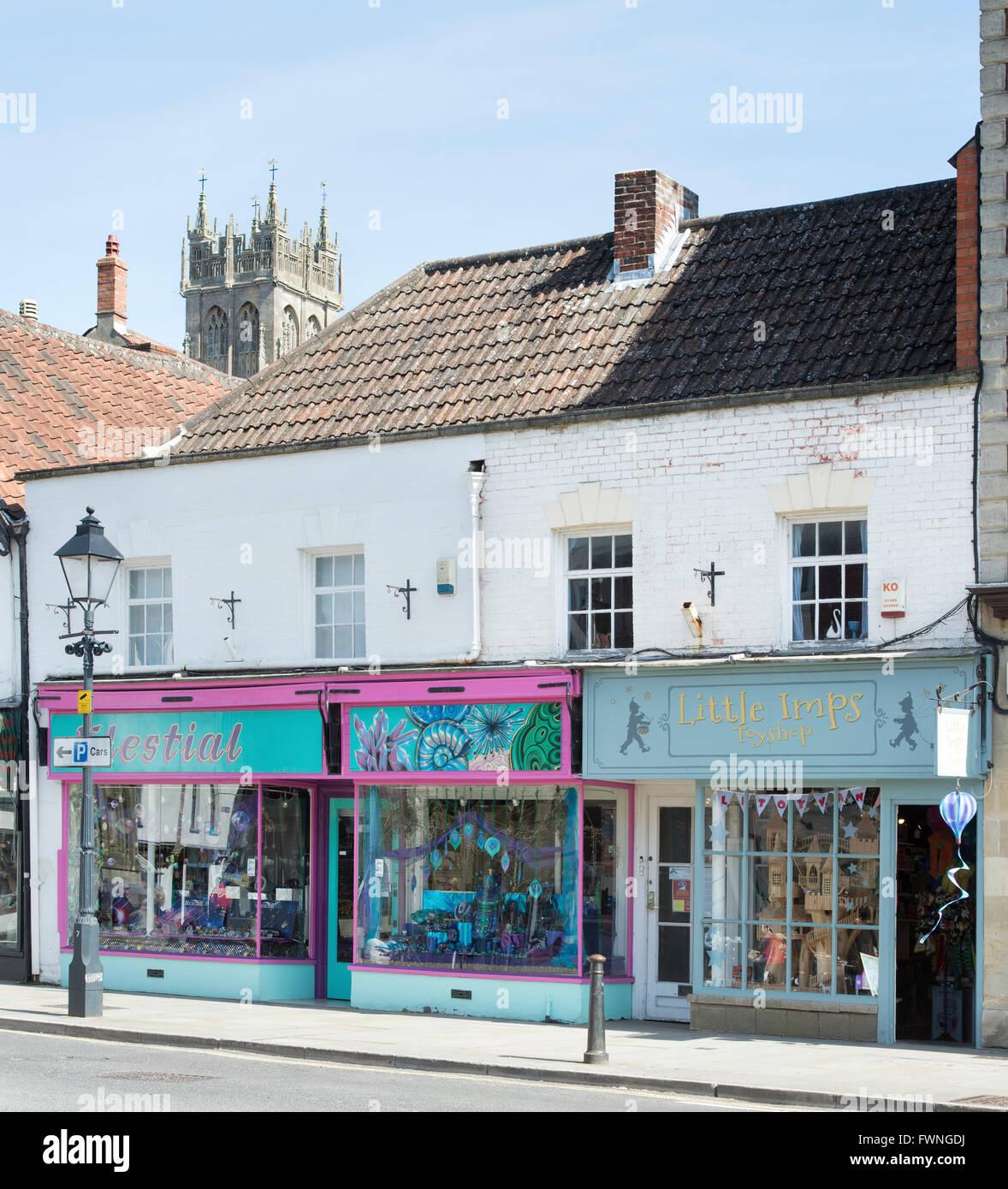 Colourful shop fronts, magdalene street. Glastonbury, Somerset, England - Stock Image