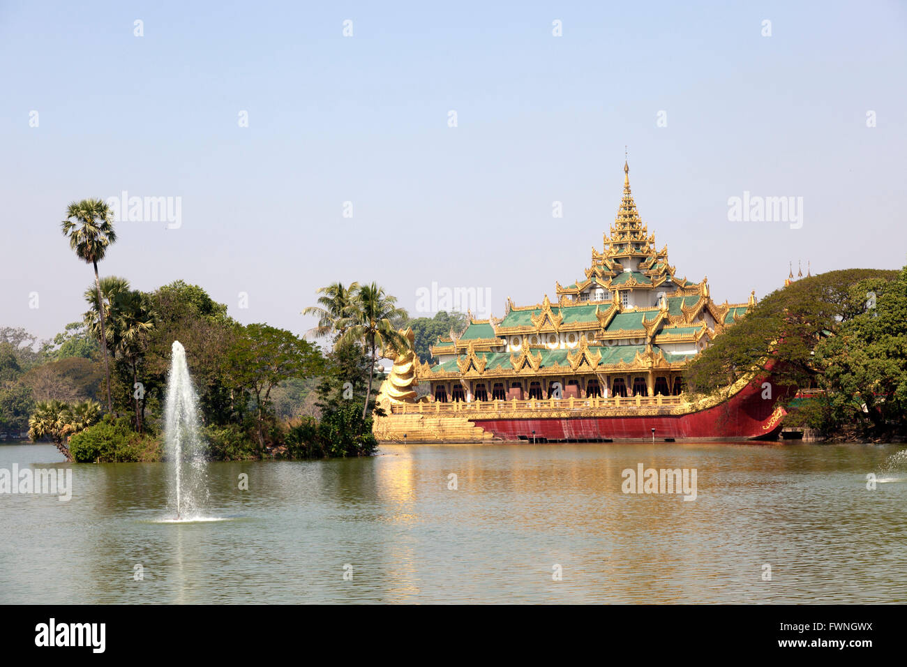 On the Eastern shore of the Kandawgyi Lake (Yangon - Myanmar), the crazy Karaweik Hall is the copy of the Royal - Stock Image