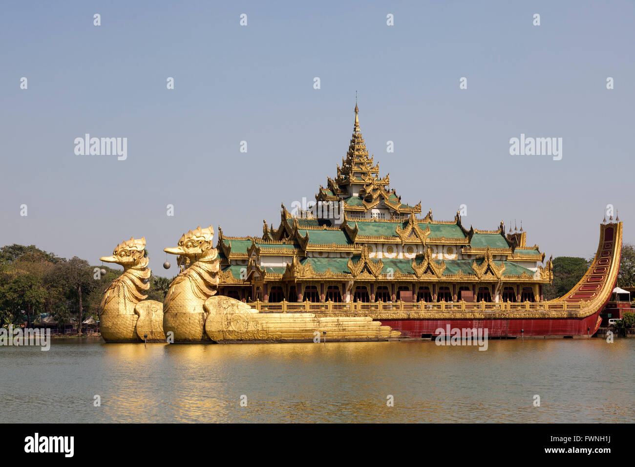 On the Eastern shore of the Kandawgyi Lake (Yangon - Myanmar), the crazy Karaweik Hall is the copy of the Royal Stock Photo