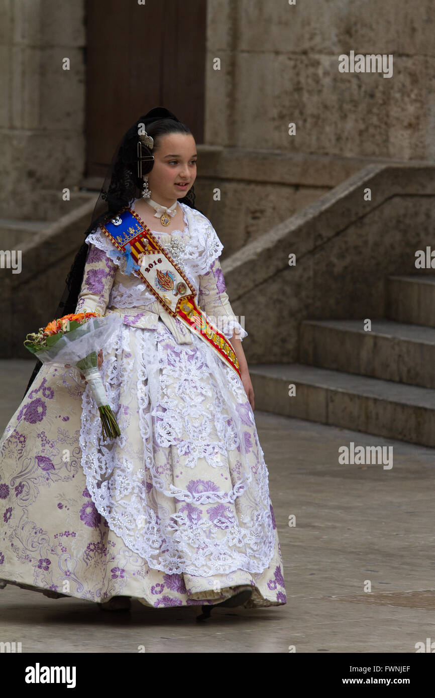 Girl walking down to the Basilica of the Lady of the Forsaken during the annual Offering procession Valencia Spain - Stock Image