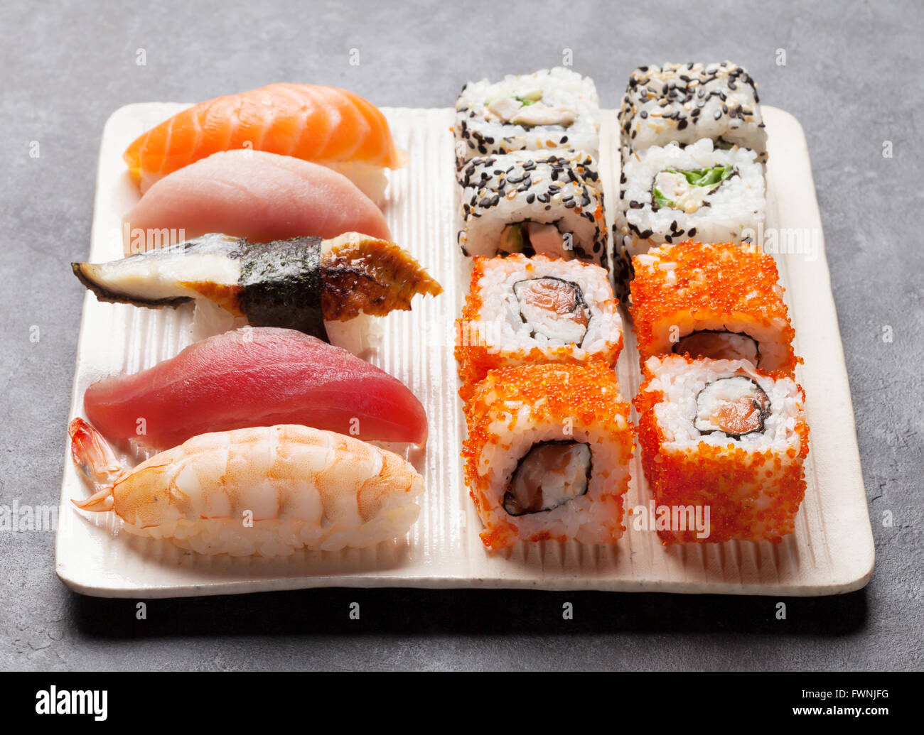 Set of sushi and maki roll on stone table - Stock Image
