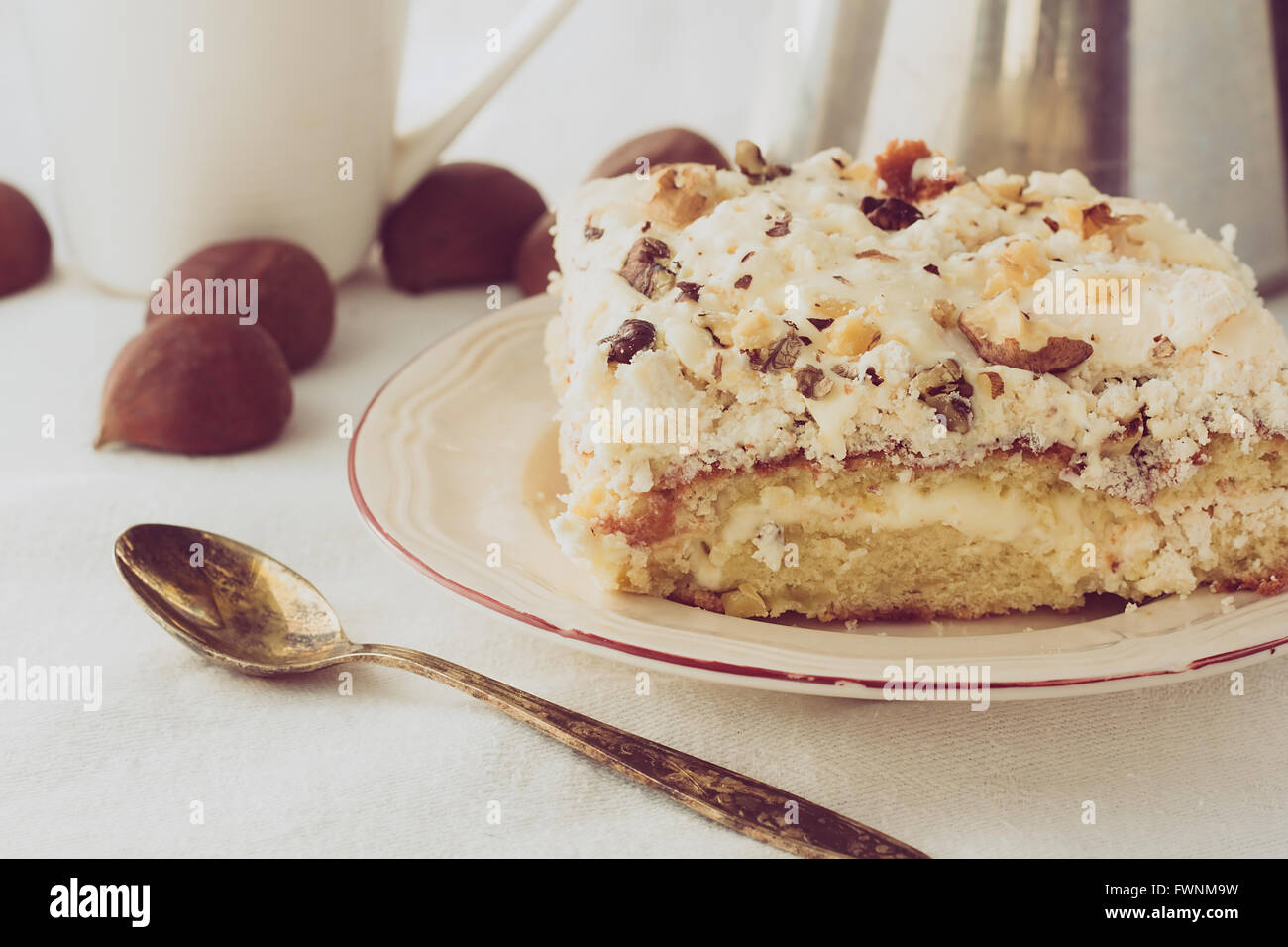 Piece of cream cake on white plate selective focus horizontal - Stock Image