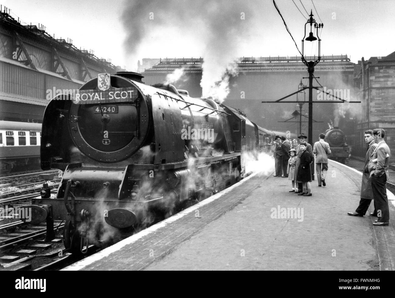 The up Royal Scot waits to leave Glasgow Central for London Euston behind Camden Pacific 'City Of Coventry'. - Stock Image