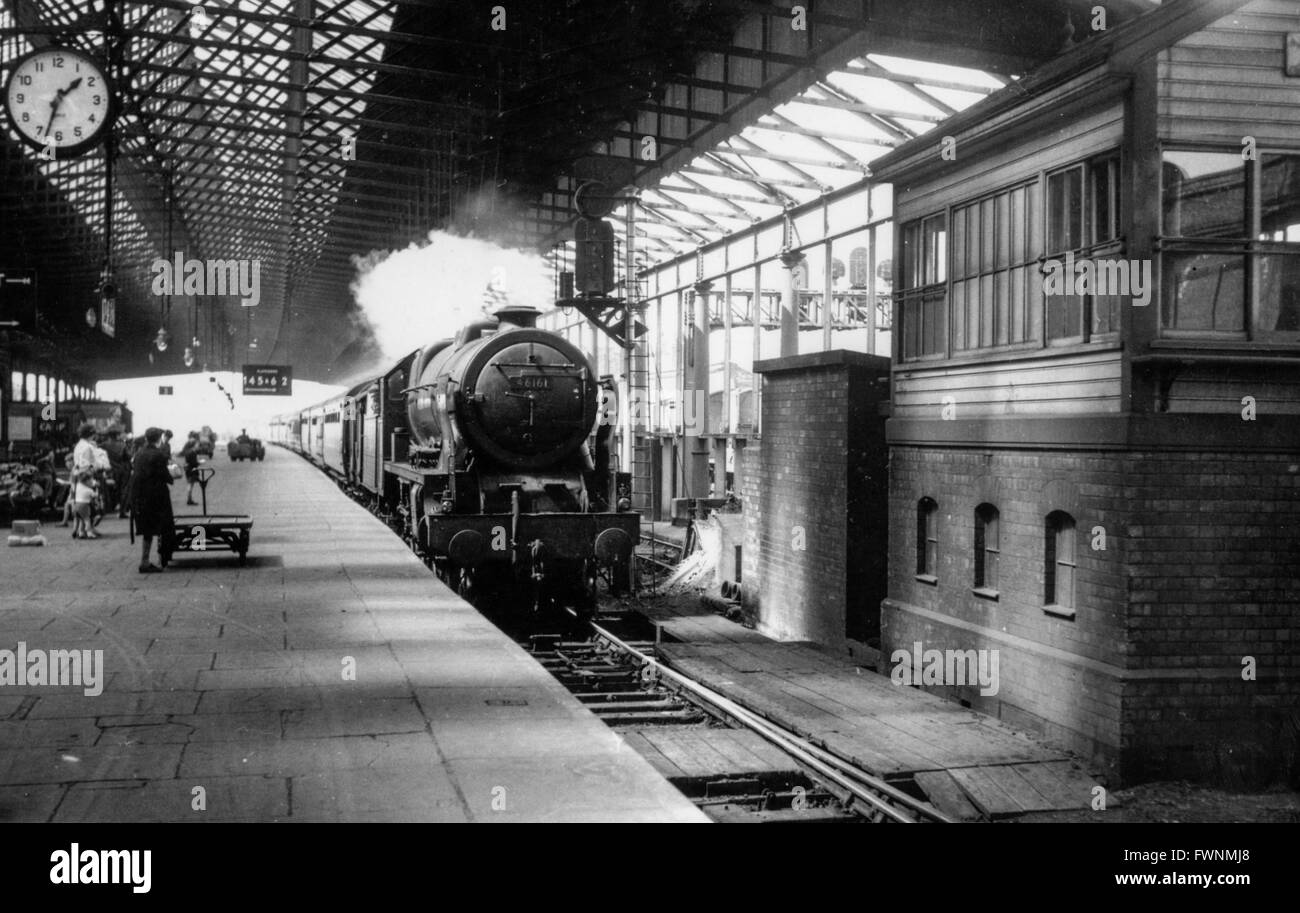 The all envoloping atmosphere of Rugby in the 1950s is caught here as Scot Class 4-6-0 No 46161. - Stock Image