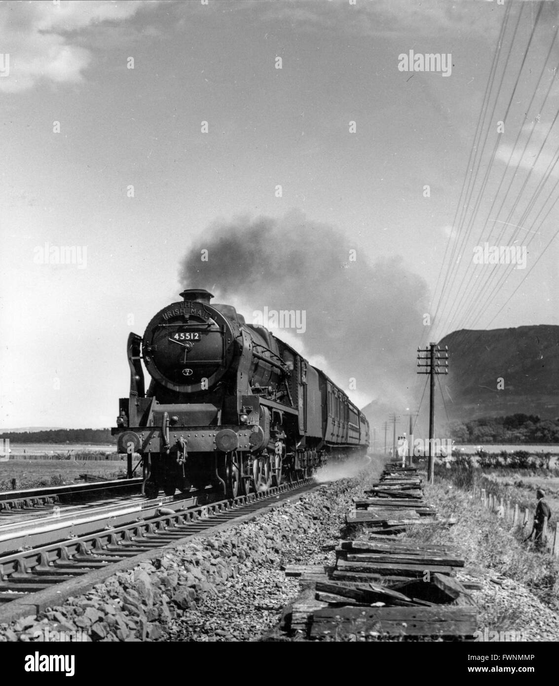 Arthur Mace's description of this picture of Patriot No 45512 'Bunsen' reads The Irish Mail in a hurry. - Stock Image