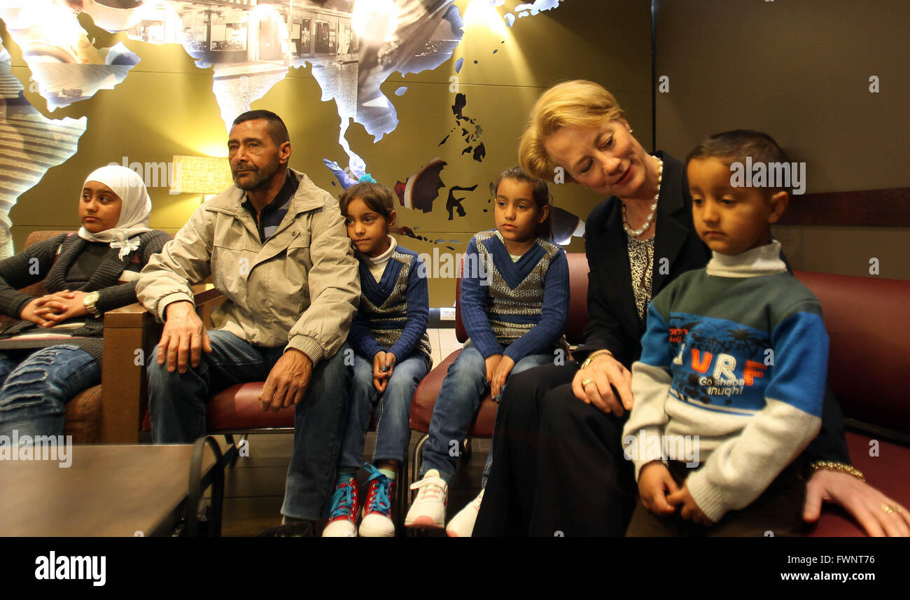 Amman. 6th Apr, 2016. U.S. Ambassador to Jordan Alice Wells (2nd R) poses for photos with Syrian refugees who will - Stock Image