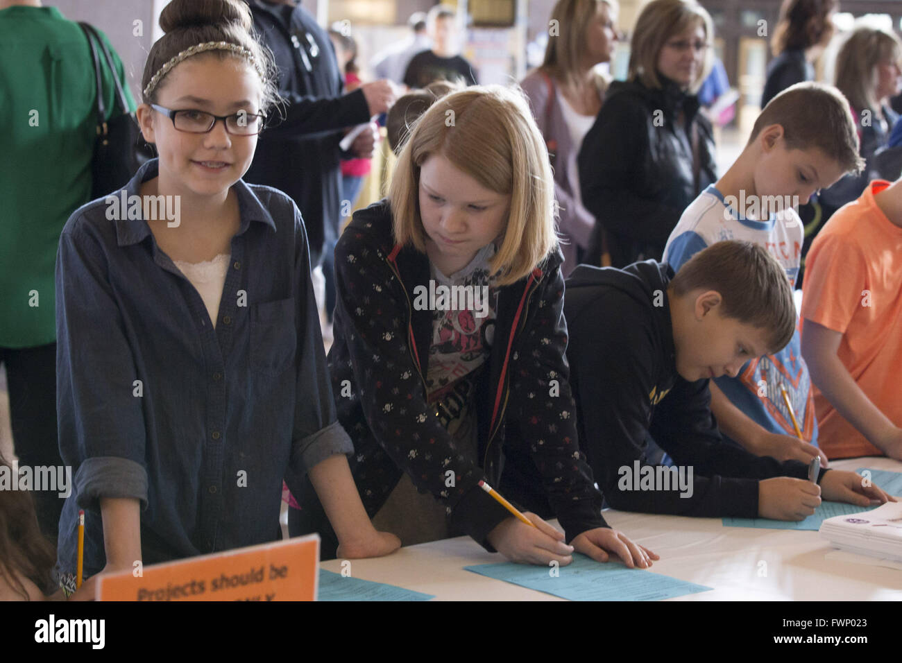 Kansas City, Missouri, USA. 5th Mar, 2016. Madison Avalos (left) and Megan Staggs (right), 5th graders, register Stock Photo