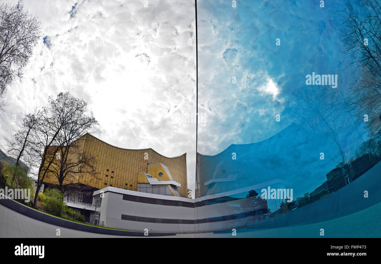 Berlin, Germany. 07th Apr, 2016. The philharmonic is reflected in the blue glass wall of the memorial to the victims Stock Photo