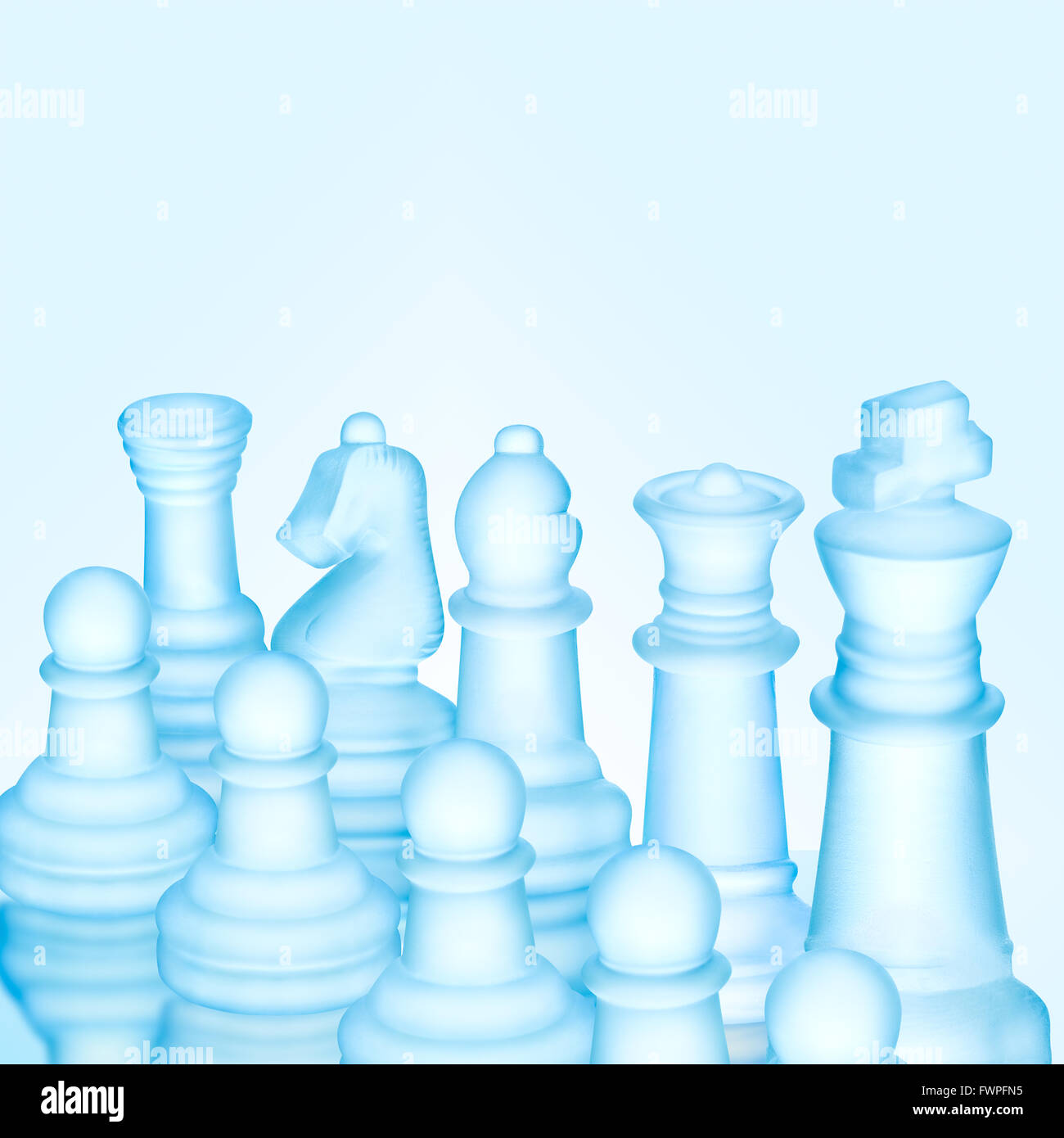 Strategy and tactics concept; icy frosted chess figures standing in a row ready for game - Stock Image