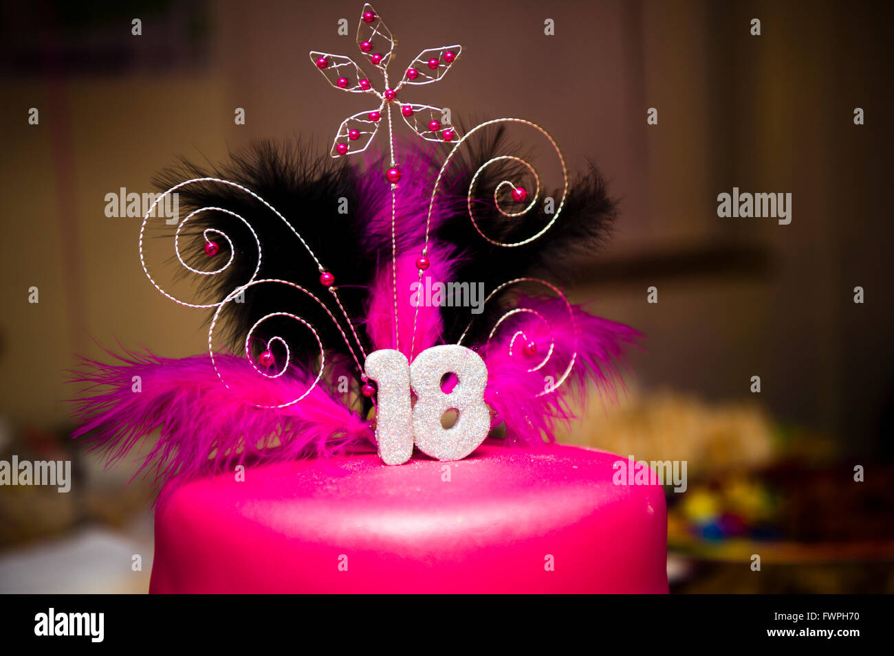 A teenage girl's 18th birthday party pink cake, UK - Stock Image