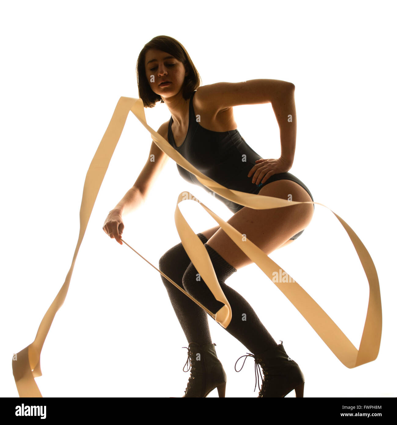 Rhythmic gymnastics : a young woman dancing with ribbons - Stock Image