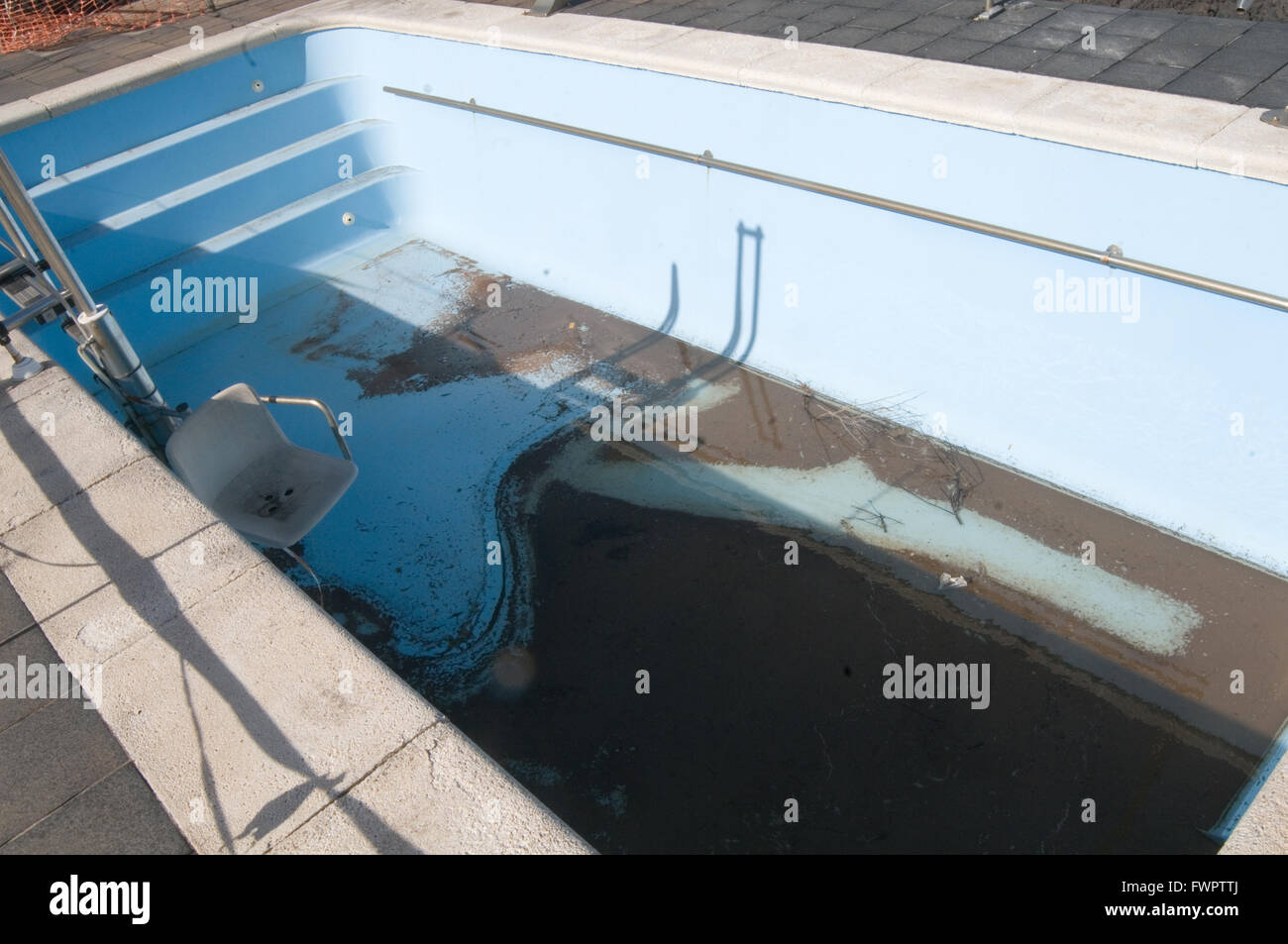 empty dirty swimming pool pools clean cleaning disused drained drain ...