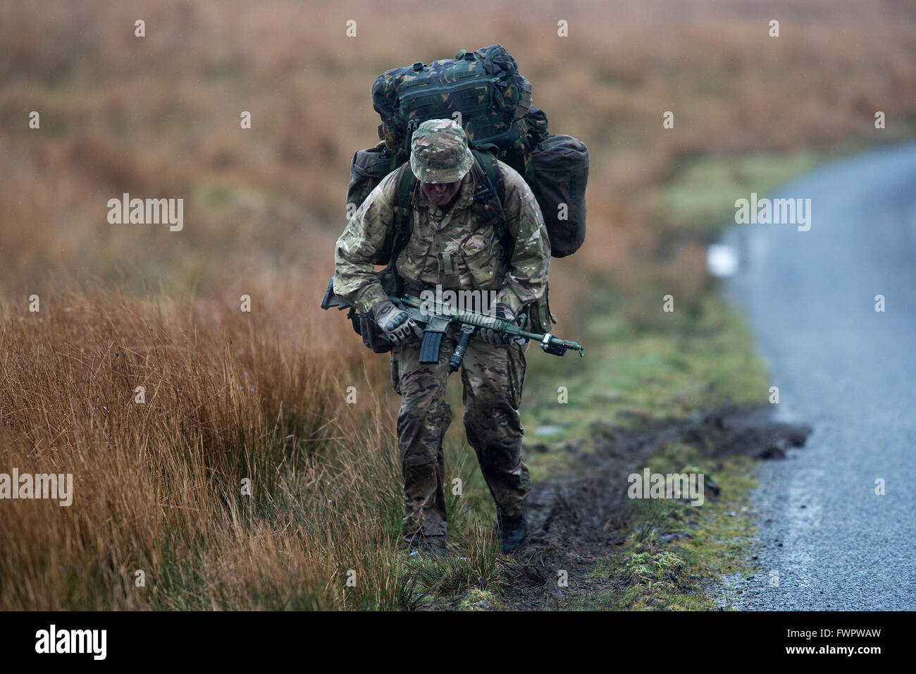 British Army soldiers train in a exercise on the moors in Scotland. - Stock Image