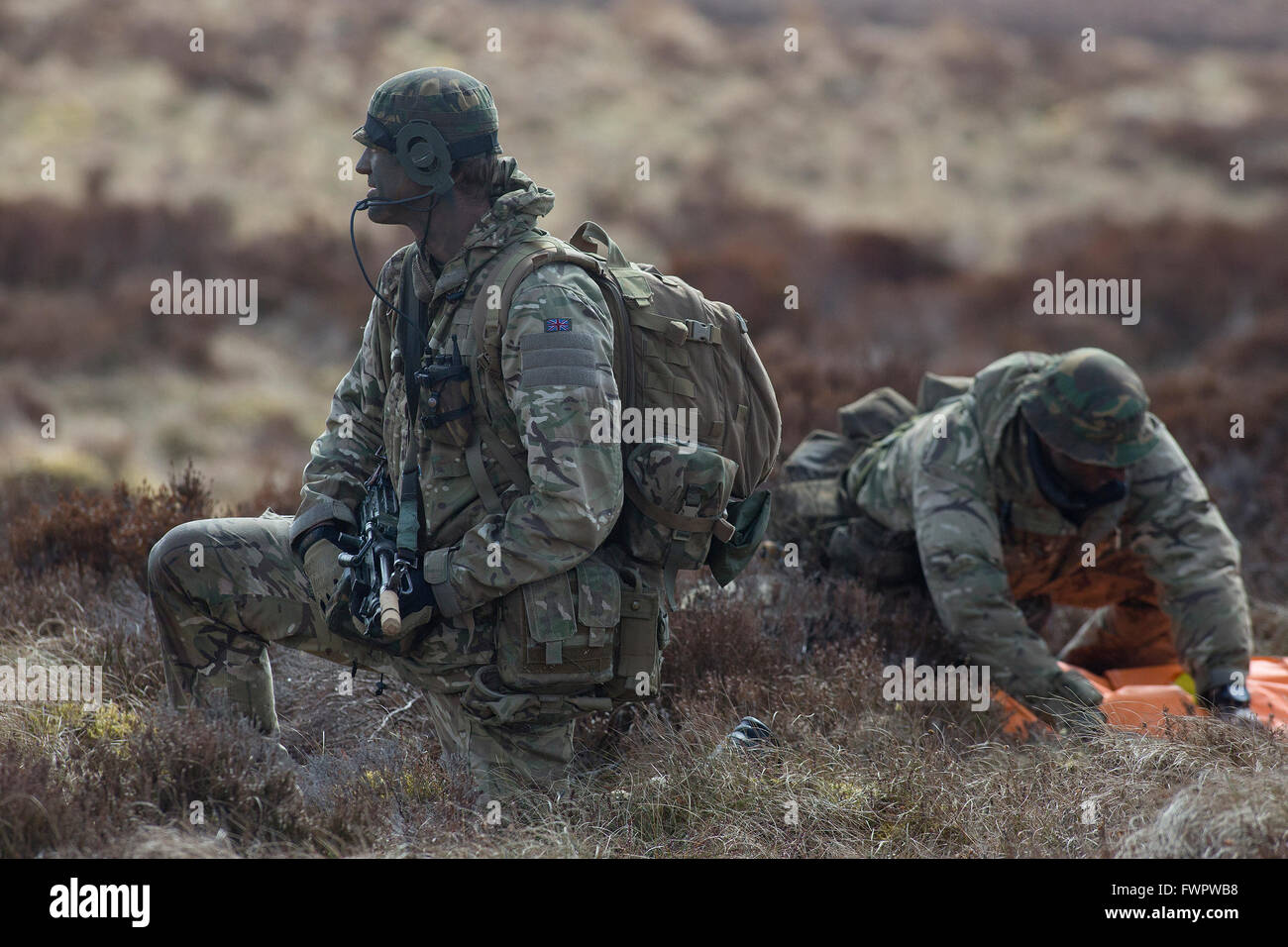 British Army commando soldiers train in a exercise on the moors in Scotland. - Stock Image