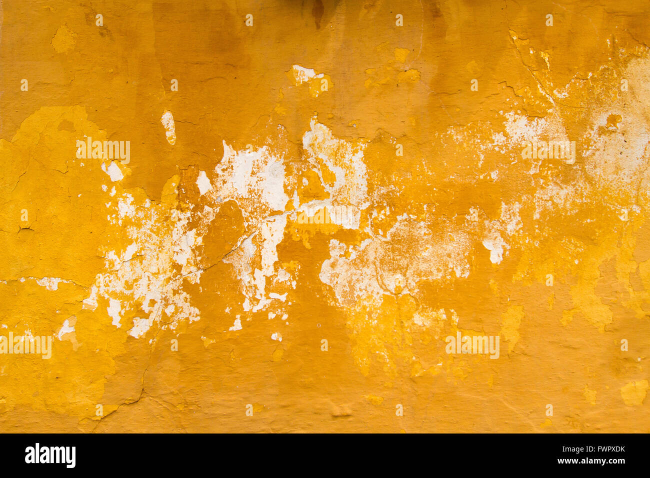 Orange-Brown-White paint peeling off old wall - Grungy stain Stock ...