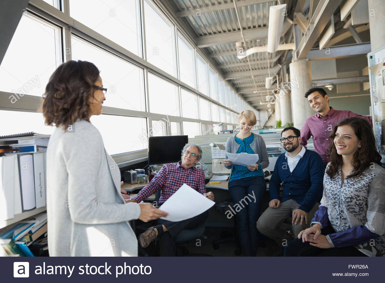 Business team gathered for a meeting - Stock Image
