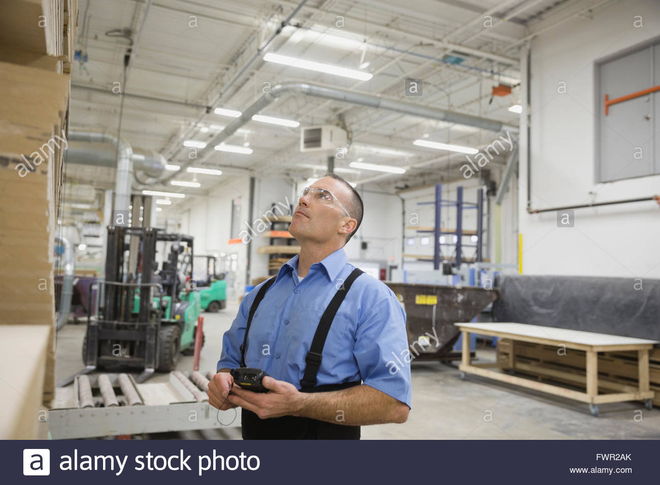 Worker with bar code reader working in warehouse - Stock Image