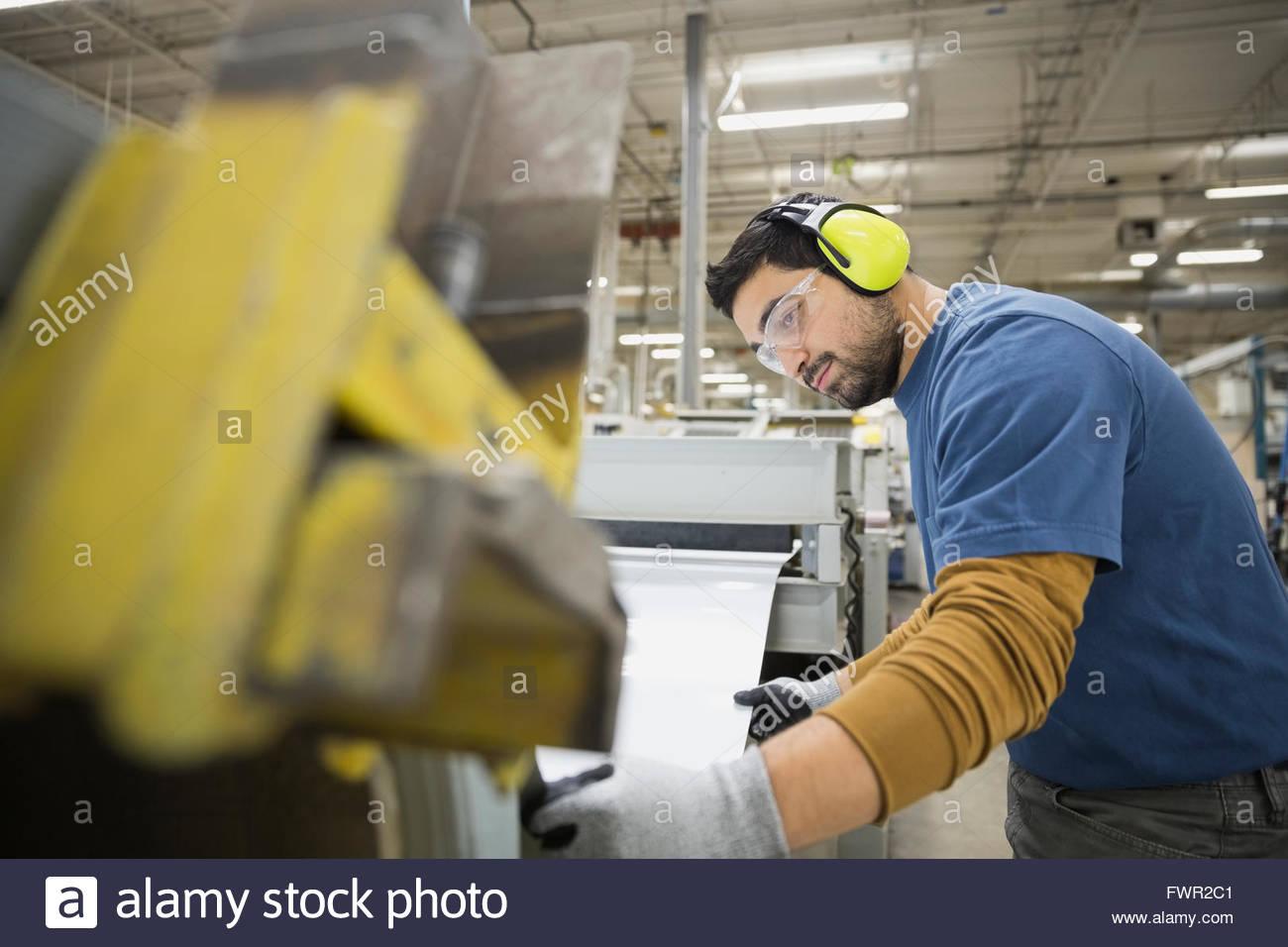 Worker in sheet metal factory - Stock Image