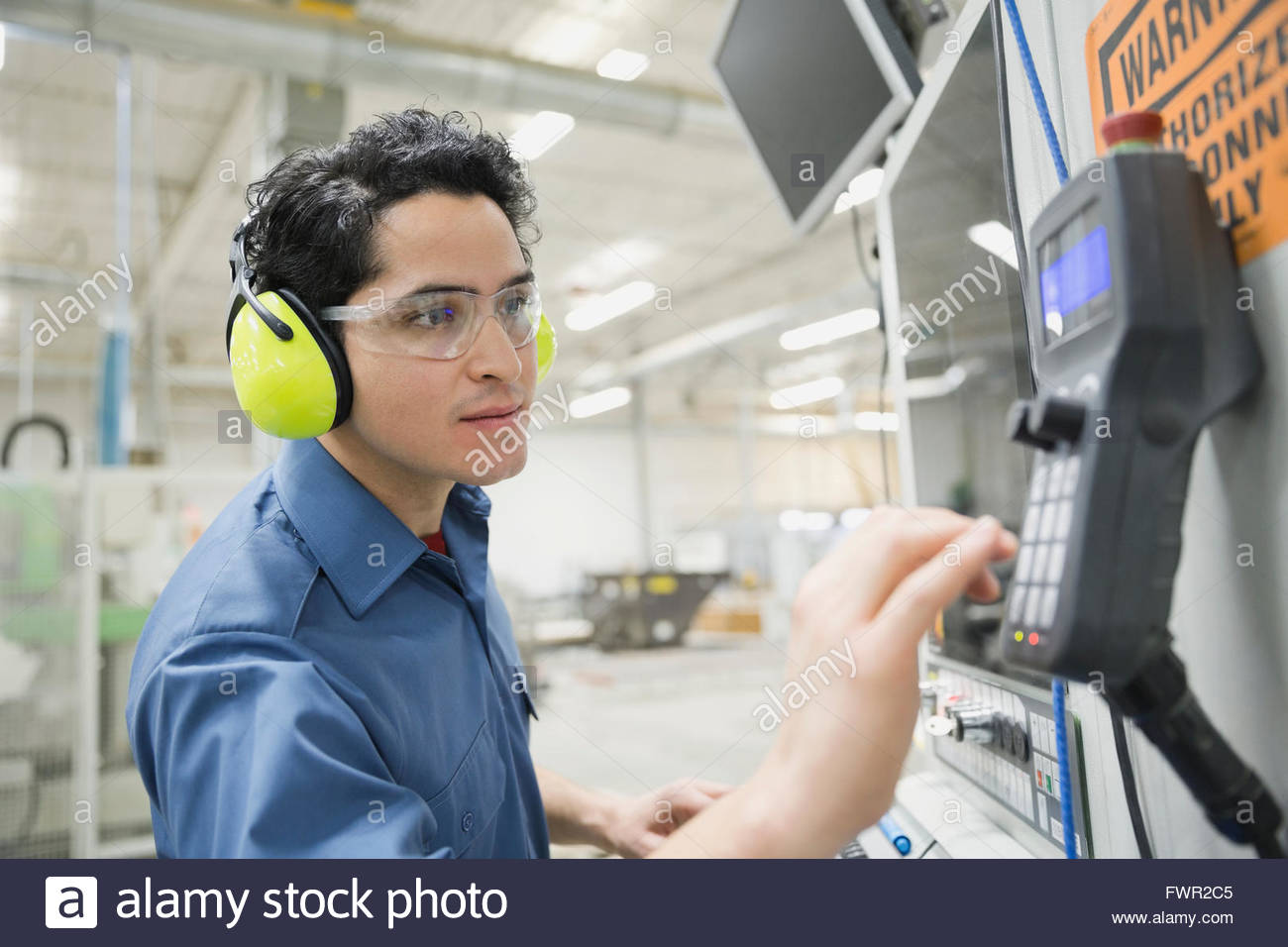 Worker in manufacturing factory - Stock Image