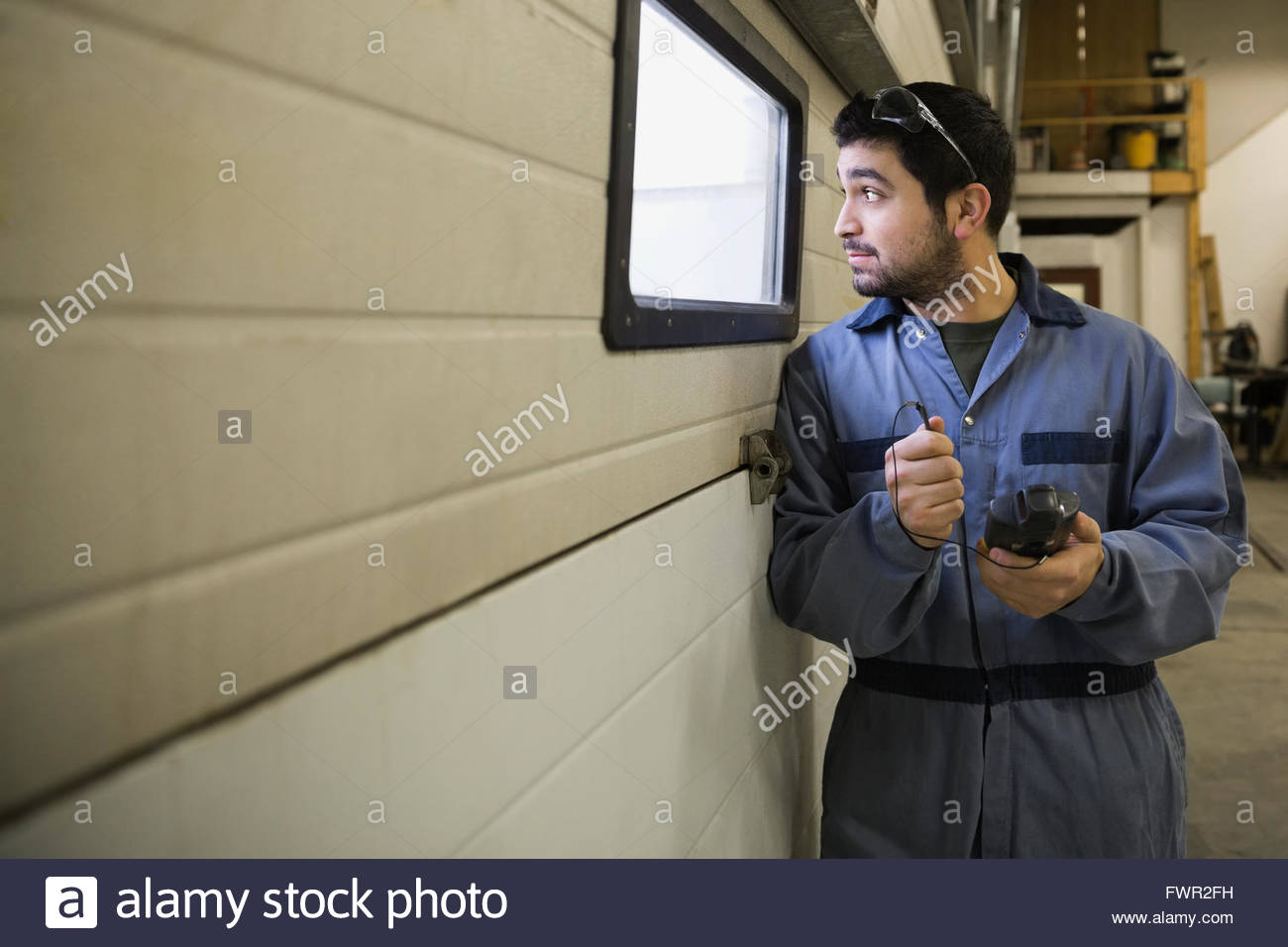 Worker with bar code reader in warehouse - Stock Image