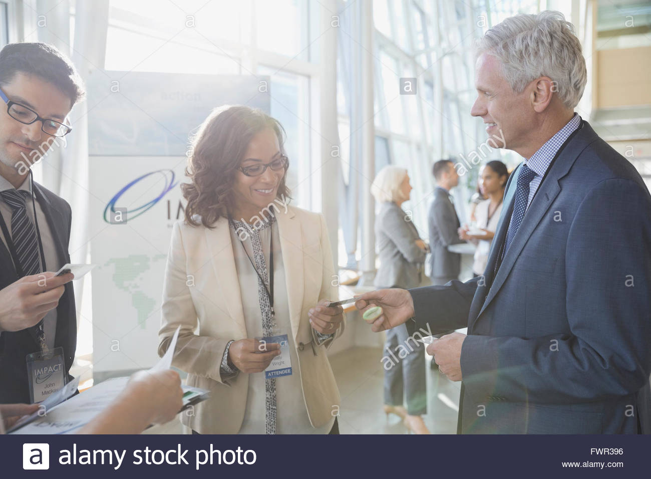 Exchanging business cards african american stock photos exchanging business professionals exchanging business cards stock image colourmoves