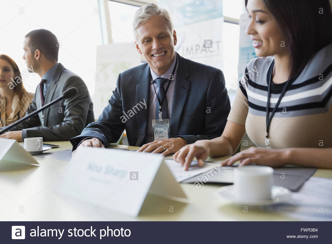 Business people discussing during conference - Stock Image