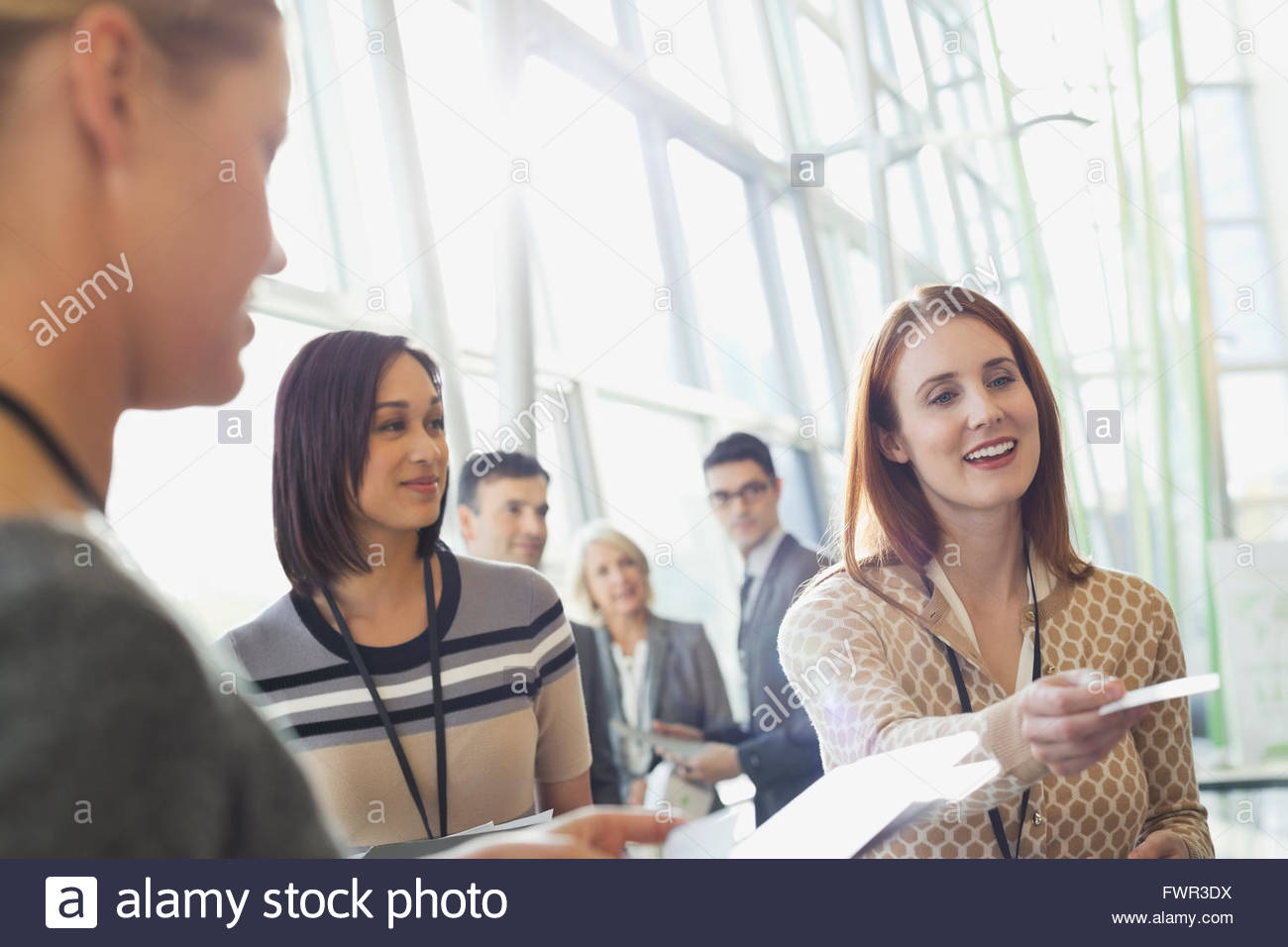 Handing out business cards stock photos handing out business cards businesswoman handing business cards out stock image colourmoves