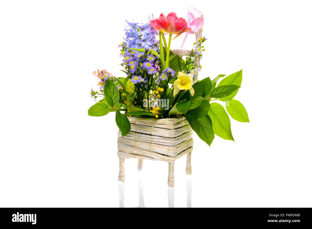 Different Type Of Wild Flowers On White Basket White Background